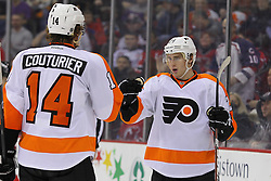 Jan 21; Newark, NJ, USA; Philadelphia Flyers right wing Matt Read (24) celebrates his goal with Philadelphia Flyers center Sean Couturier (14) during the second period at the Prudential Center.