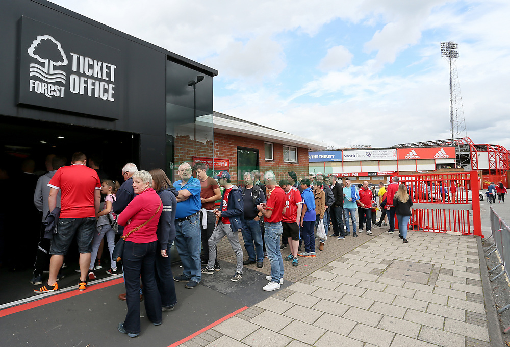 Queue of fans outside the ticket office before the pre-season match at The City Ground, Nottingham.