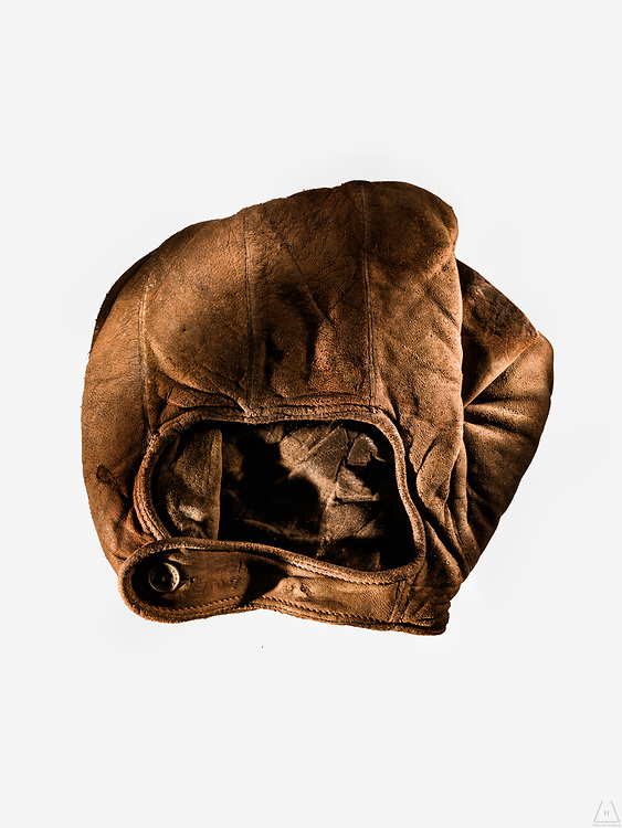 Photo isolating a rare and vintage 1910 Base Mitt in a clenched pose with details of the stitching and creased leather