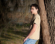 Portrait of a teenage boy in a forest setting, Brazos Bend, Texas.