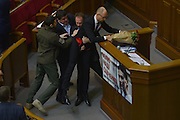 Dec. 11, 2015 - Kiev, Ukraine - <br /> <br /> Ukrainian PM attacked during his annual report<br /> <br />  Lawmakers of Ukrainian Parliament start a scuffle after MP Oleh Barna attacked Prime-minister Arsenii Yatseniuk during his debriefing. Verkhovna Rada of Ukraine debrief the year report of the Prime Minister Arsenii Yatseniuk December 11, 2015.<br /> ©Exclusivepix Media