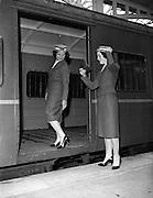 20/05/1959<br /> 05/20/1959<br /> 20 May 1959<br /> New C.I.E. Rail Hostesses -  Deirdre McVeigh, (Cork)  and Betty Vernon, (Bannagher, Co. Offaly) make last minute checks before leaving Kingsbridge Station (Hueston Station), Dublin.