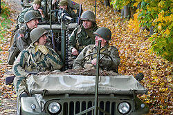 Re-enactors portrayiing members of the 82 Airborne Division wait to enter a battle battle re-enactment in Willys Jeeps on Pickering Showground<br /> <br /> 17/18 October 2015<br />  Image &copy; Paul David Drabble <br />  www.pauldaviddrabble.co.uk
