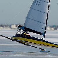 (PSTORE) Ocean Gate 1/28/2003 Keith Kennedy of Bayville has one of his runners lift off the ground in a gust of wind on the Toms River.  The larger Yankee boats traveled south in search for better ice then what was available at the Navesink River.   Michael J. Treola Staff Photographer...MJT