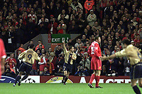 Fotball: Barcelona Marc Overmars celebrates scoring the third goal as Liverpool supporters on the Kop applaud.