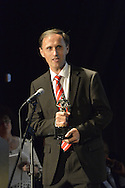 """Bellmore, New York, USA. July 21, 2016. BERNHARD RAMMERSTORFER accepts """"Alan Fortunoff Humanitarian Award"""" for documentary""""Taking the Stand"""" which he was producer, director and writer of, at The19th Annual Long Island International Film Expo Awards Ceremony, LIIFE 2016, held at the historic Bellmore Movies. LIIFE was called one of the 25 Coolest Film Festivals in the World by MovieMaker Magazine."""