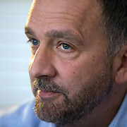 Author George Pelecanos, at his home in Silver Spring, Maryland.