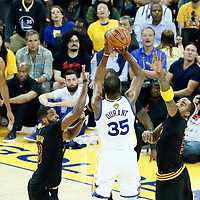 12 June 2017: Golden State Warriors forward Kevin Durant (35) takes a jump shot over Cleveland Cavaliers guard JR Smith (5) and Cleveland Cavaliers center Tristan Thompson (13) during the Golden State Warriors 129-120 victory over the Cleveland Cavaliers, in game 5 of the 2017 NBA Finals, at the Oracle Arena, Oakland, California, USA.