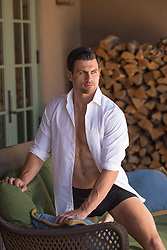 good looking man at home in underwear and an open shirt