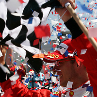 2-4, June, 2006, Milwaukee, Wisconsin, USA.<br /> Sebastien Bourdais waves the checkered flag in victory circle.<br /> &copy; 2006 Phillip Abbott/USA<br /> LAT Photographic