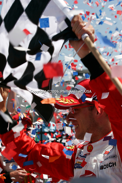 2-4, June, 2006, Milwaukee, Wisconsin, USA.<br /> Sebastien Bourdais waves the checkered flag in victory circle.<br /> © 2006 Phillip Abbott/USA<br /> LAT Photographic