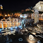 ROME, Italy - A night shot of the historic preserve of the Foro Romano (Roman Forum) in the middle of Rome, Italy, where Roman ruins are preserved.