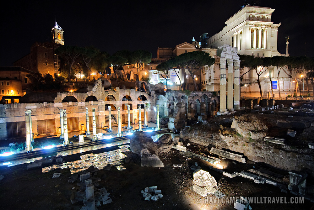 A night shot of the historic preserve of the Foro Romano (Roman Forum) in the middle of Rome, Italy, where Roman ruins are preserved.