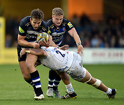 Max Clark of Bath Rugby is tackled by Luke Cowan-Dickie of Exeter Chiefs - Mandatory byline: Patrick Khachfe/JMP - 07966 386802 - 10/10/2015 - RUGBY UNION - The Recreation Ground - Bath, England - Bath Rugby v Exeter Chiefs - West Country Challenge Cup.
