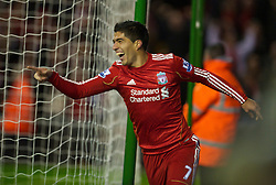 LIVERPOOL, ENGLAND - Wednesday, February 2, 2011: Liverpool's Luis Suarez celebrates scoring his side's second goal against Stoke City, minutes after coming on as a substitute to make his debut, during the Premiership match at Anfield. (Photo by David Rawcliffe/Propaganda)