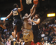 "Ole Miss center Demarco Cox (42)  shoots as Penn State forward Jeff Brooks (25) and Penn State forward Billy Oliver (35) defend at the C.M. ""Tad"" Smith Coliseum on Friday, November 26, 2010. Ole Miss won 84-71."