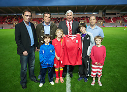 LLANELLI, WALES - Wednesday, August 15, 2012: Wales' President Phil Pritchard presents a shirt during the international friendly match against Bosnia-Herzegovina at Parc y Scarlets. (Pic by David Rawcliffe/Propaganda)