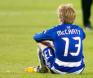 FC Dallas' Dax McCarty sits on the TFC pitch after his team's 2-1 loss to the Colorado Rapids in MLS Cup 2010.