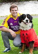 Repro Free: 27/09/2012 Leinster and Ireland rugby star, Gordon D'Arcy, got a bit of help from his dog, Wilson, when he launched GOAL Jersey Day. This annual fundraiser calls on people in companies and schools to wear their favourite jersey with pride on Friday 5th October. For your Jersey Day pack, call 01 2809779 or visit www.goal.ie  Picture Andres Poveda