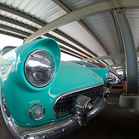 The timeless '55 Ford Thunderbird...chrome for days and a headlight style that lives on in nearly School bus or traffic lamp...notice that gentle curving schroudd over the top half of the headlight.
