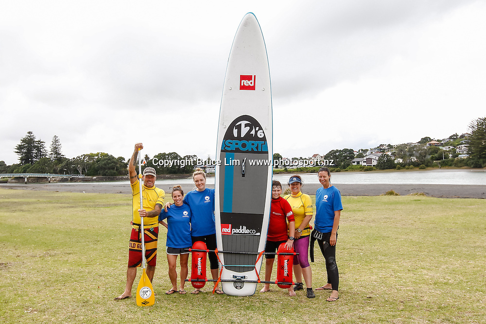 Devon, the Flight Centre crew, Keith Jarmey (L) and Justine Quarrell from Raglan Water Sports, pose for a photo during the Flight Centre Halberg Disability Sport Foundation Raglan Surf Day on Sunday 20 March 2016.<br /> <br /> Copyright Photo: Bruce Lim / www.photosport.nz
