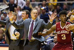 Jan 18, 2017; Morgantown, WV, USA; Oklahoma Sooners head coach Lon Kruger holds back his team after a made basket late in the second half against the West Virginia Mountaineers at WVU Coliseum. Mandatory Credit: Ben Queen-USA TODAY Sports