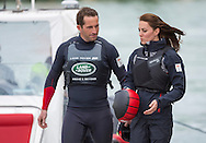 The Duchess of Cambridge with Sir Ben Ainslie just before boarding one of his America's Cup catamarans during a visit to the Land Rover BAR base in Portsmouth, Hampshire. <br /> Picture date Friday 20th May, 2016.<br /> Picture by Christopher Ison. Contact +447544 044177 chris@christopherison.com