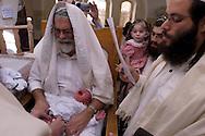 A new born boy's Brit Milla (circumcision) ceremony in Hebron's Jewish community..Hebron, Israel. 05/11/207.Photo © J.B. Russell/Blue Press