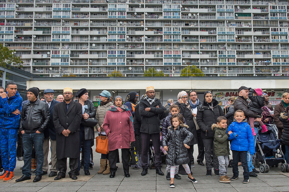 "10 years ago, on 27 October 2005, riots broke out in the French suburbs. Residents from La Courneuve, a suburb at 5 km from Paris, wait for the visit of President Francois Hollande. In the background, the 15-story high apartment complex Mail de Fontenay, part of the so called ""4000"" complex, flats that have been built here in 1964. 20 October 2015, La Courneuve, France."