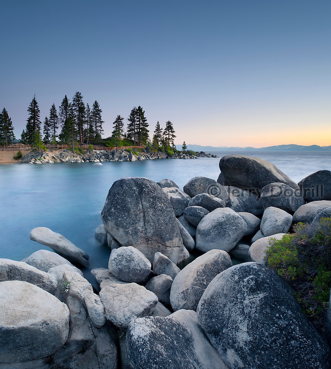 Granite boulders along a sandy bottom lagoon in Sand Harbor State Recreation Area on Lake Tahoe's East Shore. Lake Tahoe is a large freshwater lake in the Sierra Nevada mountain range on the California/Nevada Border. At a surface elevation of 6,225 ft Lake Tahoe is the largest alpine lake in North America with a depth of 1,645 ft.