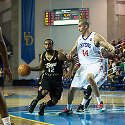 Erie BayHawks Guard Lewis Jackson (12) drives towards the basket as Delaware 87ers Center Ben Strong (44) defends in the second half of a NBA D-league regular season basketball game between Delaware 87ers (76ers) and the Erie BayHawks (Knicks) Friday, Jan. 3, 2014 at The Bob Carpenter Sports Convocation Center, Newark, DE