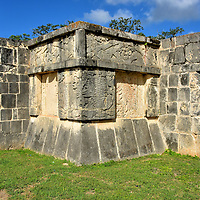 Eagles and Jaguars Platform at Chichen Itza, Mexico<br /> The Platform of Eagles and Jaguars is adorned with four serpent sculptures at the corners plus elaborate carvings along the base. The eagles represent the Eagle Knights, a group of elite Mayan archers. The jaguars are a tribute to the Jaguar Knights. They were highly-skilled and aggressive soldiers noted for their fierce, hand-to-hand combat. The reclining figure is a chacmool, believed to symbolize a slain warrior offering sacrificial gifts to the gods. A similar statue was uncovered at the platform's base in 1875 by Augustus Le Plongeon, one of fourteen found at Chichen Itza created between 800 - 900 AD. Archeologists estimate Platforma de las Aguilas y los Jaguares was built sometime between 900 – 1200 AD during the Early Postclassic period.