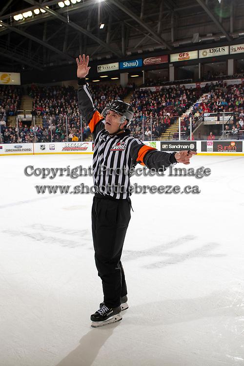 KELOWNA, BC - OCTOBER 12: Referee Tyler Adair signals the bench at the Kelowna Rockets against the Kamloops Blazers at Prospera Place on October 12, 2019 in Kelowna, Canada. (Photo by Marissa Baecker/Shoot the Breeze)