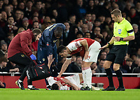 Football - 2018 / 2019 FA Cup - Fourth Round: Arsenal vs. Manchester United <br /> <br /> Laurent Koscielny (Arsenal FC) lies injured after a tackle with Romelu Lukaku (Manchester United) at The Emirates Stadium.<br /> <br /> COLORSPORT/DANIEL BEARHAM
