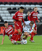 Marcus Tavernier (7) of Middlesbrough battles for possession with George Byers (28) of Swansea City during the EFL Sky Bet Championship match between Swansea City and Middlesbrough at the Liberty Stadium, Swansea, Wales on 14 December 2019.