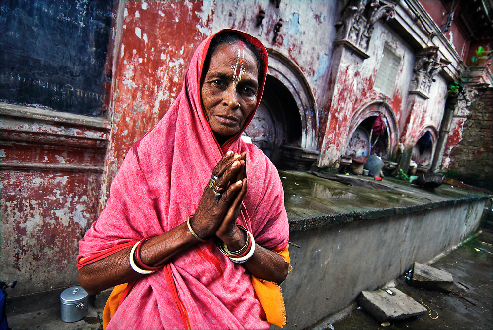 In the shadow of Armenian Ghat in Kolkata, so-called because it was once the place where rich Armenians docked their ships full of precious stones and spices, a Hindu woman begs for a few Rupees.  © Steve Raymer / National Geographic Creative