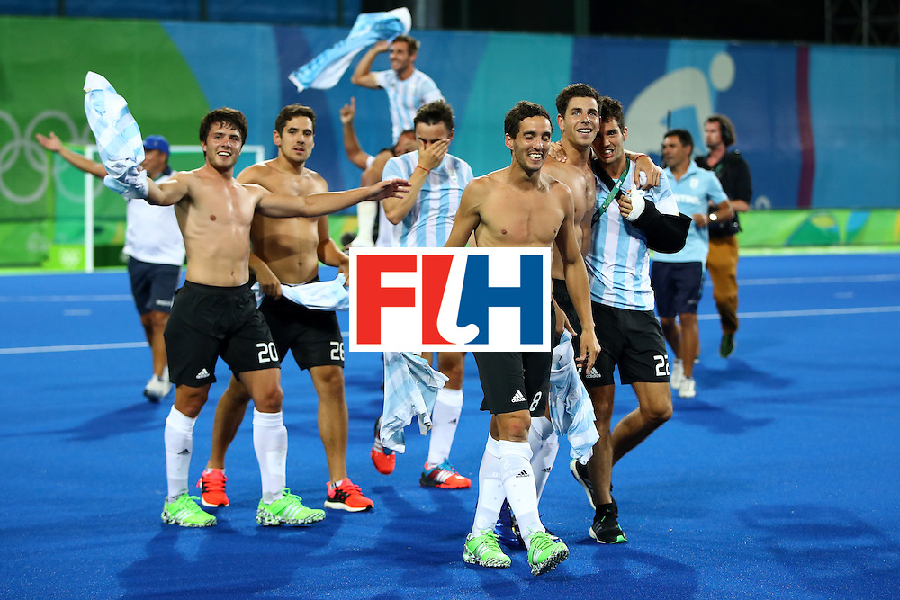 RIO DE JANEIRO, BRAZIL - AUGUST 18:  Lucas Rey #8 of Argentina celebrates with team mates after winning the Men's Hockey Gold Medal match between Belgium and Argentina on Day 13 of the Rio 2016 Olympic Games at Olympic Hockey Centre on August 18, 2016 in Rio de Janeiro, Brazil.  (Photo by Clive Brunskill/Getty Images)