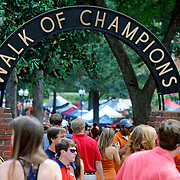 People walk down the Walk of Champions in The Grove before an NCAA college football game between Mississippi and Texas in Oxford, Miss., Saturday, Sept. 15, 2012. (Photo/Thomas Graning)
