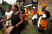 Xhosa women sing and dance while welcoming home young male family members, who have spent one month in an initiation camp, where they have been circumcised and initiated into manhood. The township Khayalethu South in Knysna, South Africa, in December 2006.