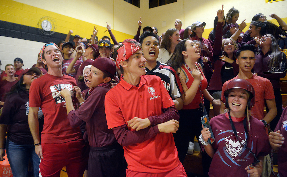 gbs091316b/SPORTS -- Sandia Prep fans yell for their team during the game at St. Pius on Tuesday, September 13, 2016. (Greg Sorber/Albuquerque Journal)