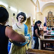 An angel statue holds the holy water for visitors to the Cathedral of San Gervasio (Catedral De San Gervasio) in Valladolid in the heart of Mexico's Yucatan Peninsula.