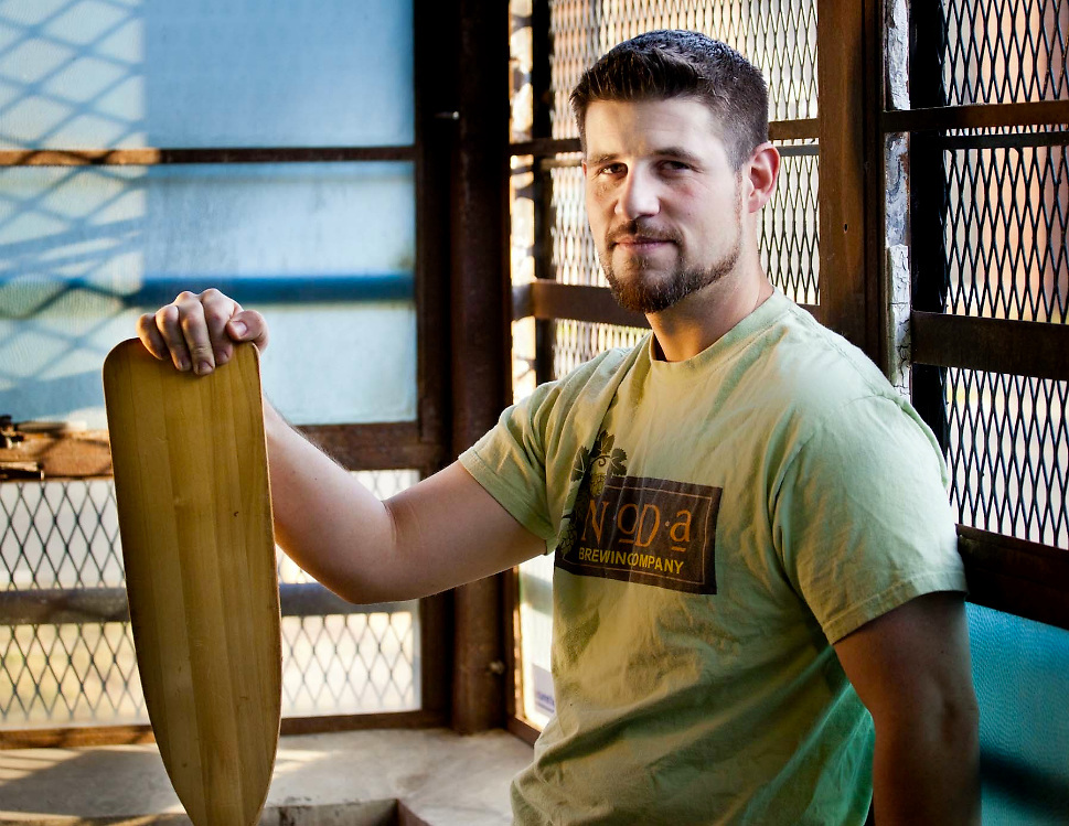 Chad is the brewer at NoDa Brewing Company. Here he stands with his trusty paddle used to stir the hoppy goodness.