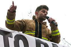 London, UK. 16th March, 2019. Ricardo la Torre, Regional Secretary of the Fire Brigades Union (FBU) Eastern Region, addresses thousands of people on the March Against Racism demonstration on UN Anti-Racism Day against a background of increasing far-right activism around the world and a terror attack yesterday on two mosques in New Zealand by a far-right extremist which left 49 people dead and another 48 injured.