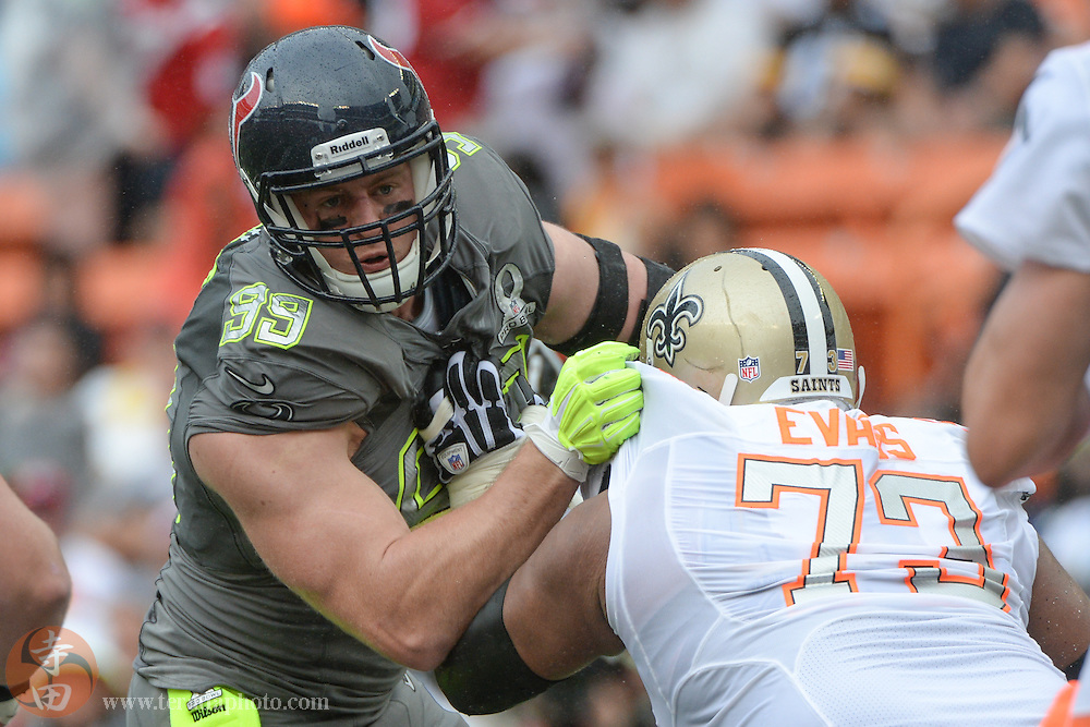 January 26, 2014; Honolulu, HI, USA; Team Sanders defensive end J.J. Watt of the Houston Texans (99) rushes against Team Rice offensive guard Jahri Evans of the New Orleans Saints (73) during the third quarter of the 2014 Pro Bowl at Aloha Stadium. Team Rice defeated Team Sanders 22-21.