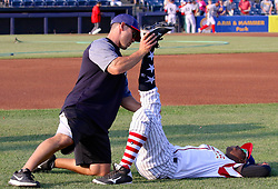 July 5, 2017 - Trenton, New Jersey, U.S - Trenton Thunder Strength Coach ANTHONY VELAZQUEZ helps Thunder player JORGEO MATEO stretch before the game tonight vs. the Fightin Phils. The team wore patriotic uniforms for the games on July 4th and today, July 5th. (Credit Image: © Staton Rabin via ZUMA Wire)