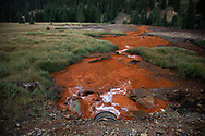 Polutted water streams down from mining operations into the Animas River in Silverton Colorado.