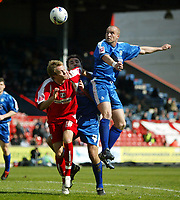 Photo: Chris Ratcliffe.<br />Leyton Orient v Boston United. Coca Cola League 2. 08/04/2006.<br />Paul Connor (L) of Leyton Orient is beaten to the ball by Alan White of Boston United. Centre is Michael Simpson for Boston