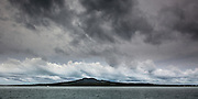 Rangitoto Island, symmetry on the horizon. Overcasr day, with interesting cloud and colour.