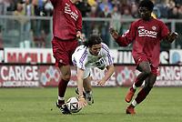 Livorno 17-4-05<br />Livorno Fiorentina Campionato serie A 2004-05<br />nella  foto Pazzini contrastato da Alessandro Lucarelli (sx) e Usei<br />Foto Snapshot / Graffiti