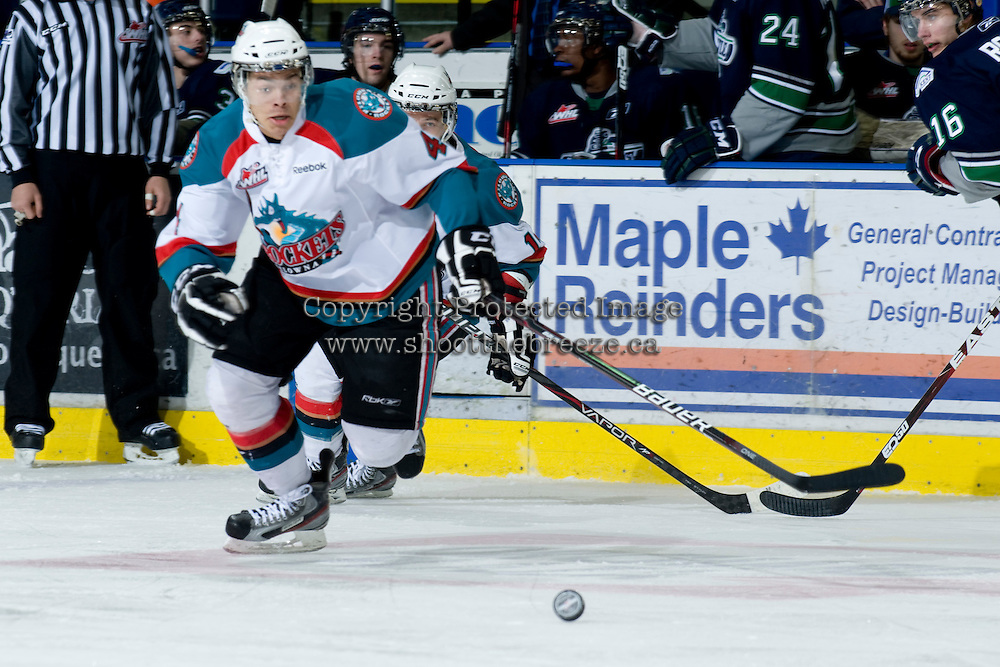 KELOWNA, CANADA, JANUARY 27: Madison Bowey #4 of the Kelowna Rockets skates for the puck as the Seattle Thunderbirds visit the Kelowna Rockets on January 27, 2012 at Prospera Place in Kelowna, British Columbia, Canada (Photo by Marissa Baecker) *** Local Caption ***